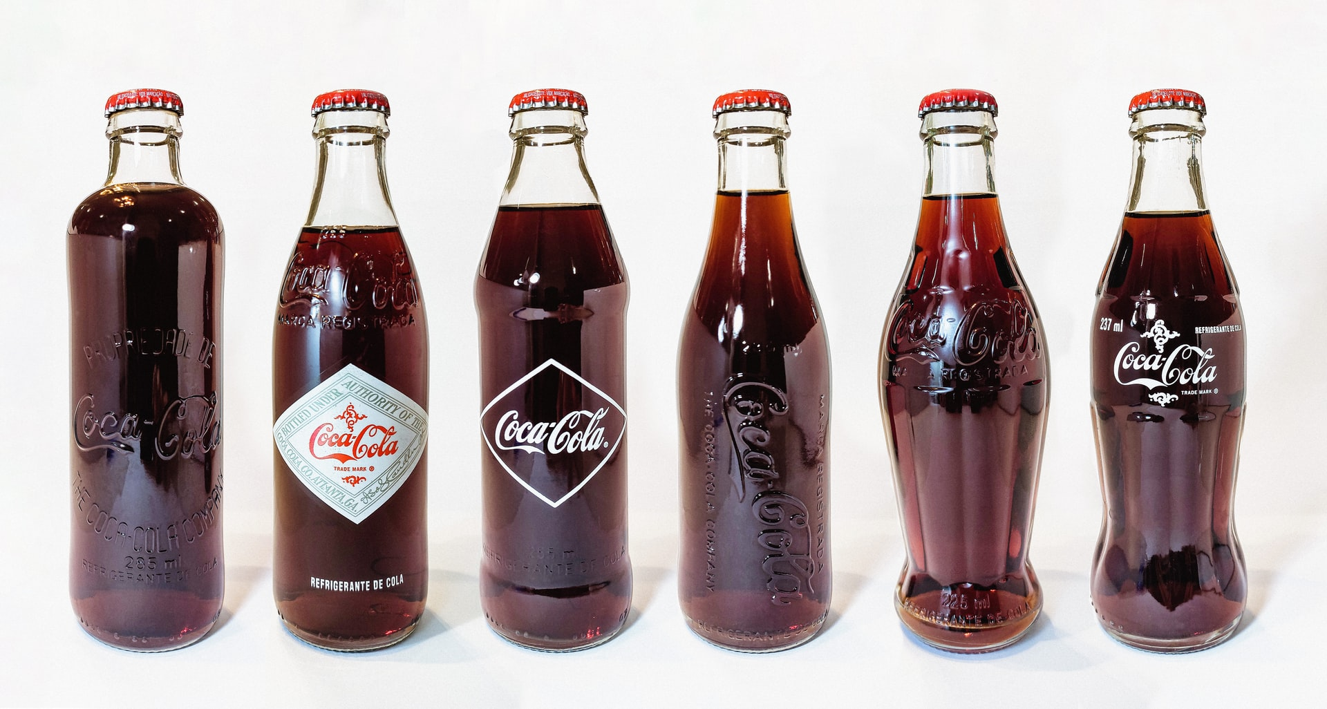 The evolution of the Coca Cola bottles
