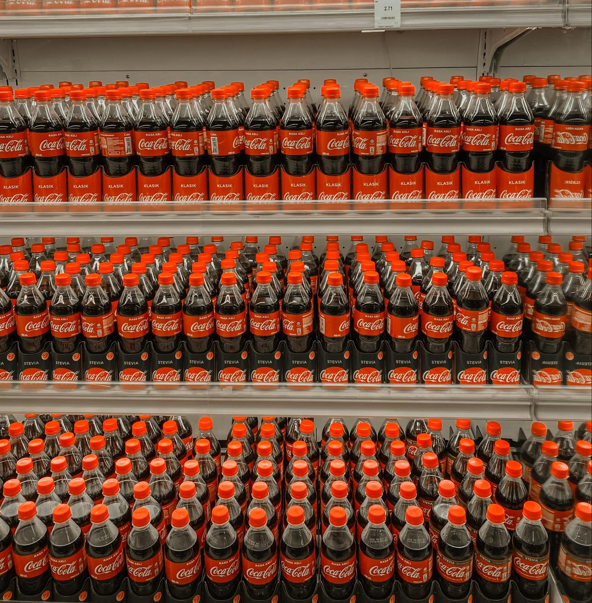 A shelf with drinks from Coca Cola